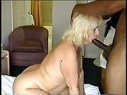 Plus-size blonde screwed by big dicked black stranger while husband takes image